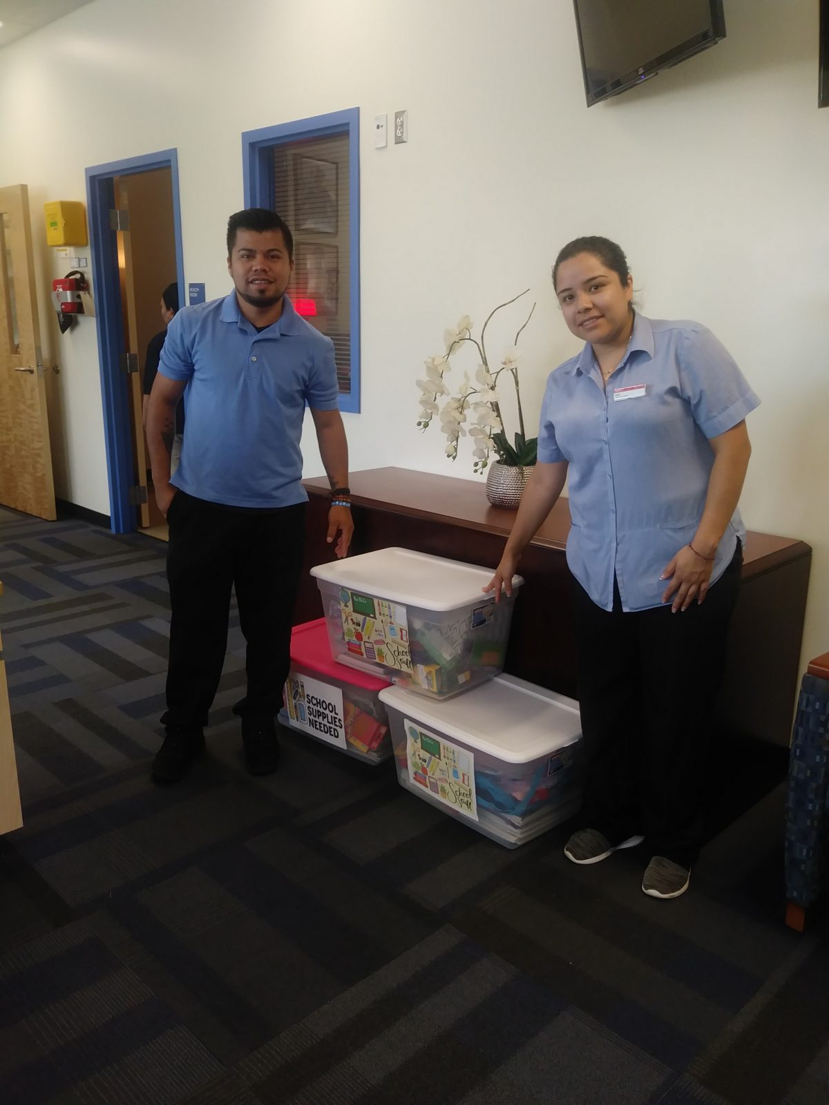 Two employees donate school supplies to Nations Ford Elementary